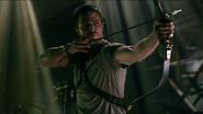 Oliver aims an arrow at tennis balls