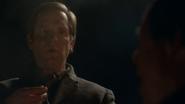 Eobard Thawne looks down at Harrison Wells
