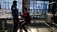 Ray Palmer performs tests the miniaturization