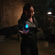 Nora Darhk holding the water totem