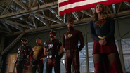 Supergirl, Flash, Steel, Firestorm and Atom with mr. president