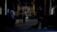 Team Flash look in the wormhole in S.T.A.R. Labs
