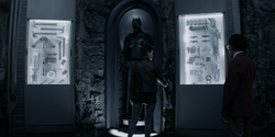 Kate and Luke in Batman's cave.png