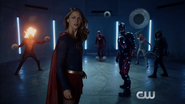 The heroes look at the elevator girl during Superhero Fight Club