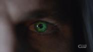 Oliver Queen's eyes glow