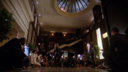 Oliver stops Evelyn's attack at Star City Plaza Hotel