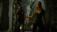 Sara Lance, Quentin Lance and The Arrow fight in members of the League of Assassins (2)