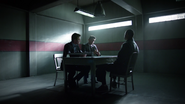 Adrian and Oliver talk with John in prison