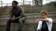 John Constantine and Manny talk in park