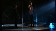 Oliver is chained up by Malcolm Merlyn