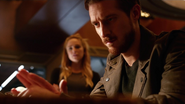 Rip Hunter and Sara Lance talk about a mission (1)