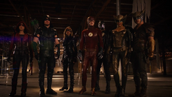 Speedy, Green Arrow, Black Canary, The Flash, Spartan, Hawkgirl and Carter Hall after facing Vandal Savage.png