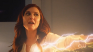 Speed Force, manifesting itself as Nora Allen, emitting yellow and white lightning