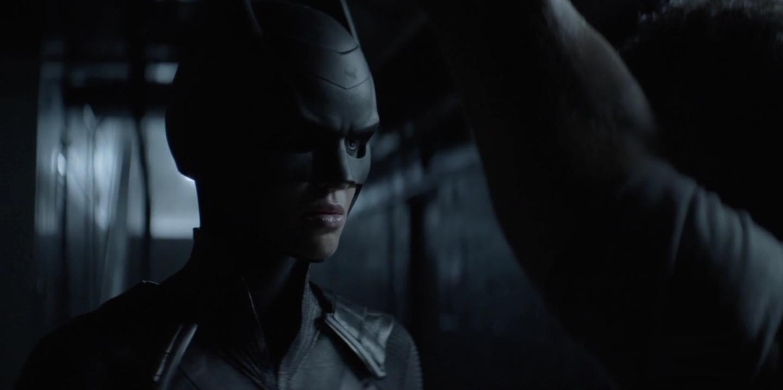 Batwoman about to interrogate Dodgson.png