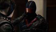 Green Arrow tries to unmask Vigilante