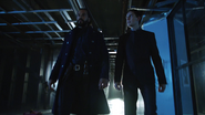 Vandal Savage and Caleb in secret laboratory (1)