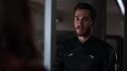 Mon-El in the Legion suit