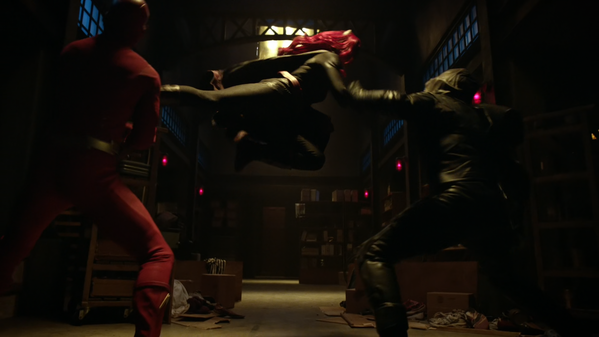Batwoman subduing the Flash and Green Arrow.png