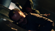 The Hood warns Quentin about Deadshot