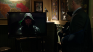Oliver broadcasts his opening speech as the Green Arrow