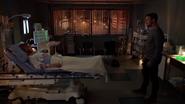 Oliver at Laurel's bedside