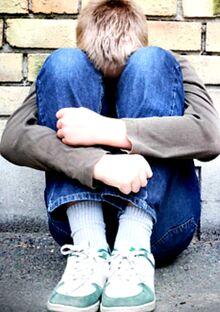 Anxious Autistic teen boy in fetal position .jpg