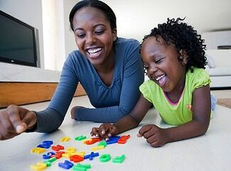 Woman and Child Playing with Letters from blackdoctor.jpg
