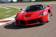 2014-Ferrari-LaFerrari-front-three-quarter-in-motion-turn1