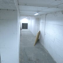A Hallway Leading To A Exit