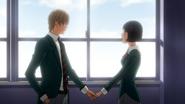 Uścisk ręki Iwase i Takagiego