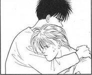 Eiji gives Ash a hug