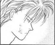 Ash looks over Eiji sleeping