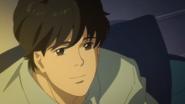 Eiji smiles at Ash