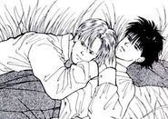 Ash lays on top of Eiji