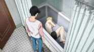 Eiji notices Ash sleeping in the shower