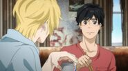 Eiji hides his laughter from the story Ash told