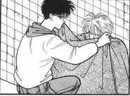 Eiji puts a blanket over Ash as he's sleeping
