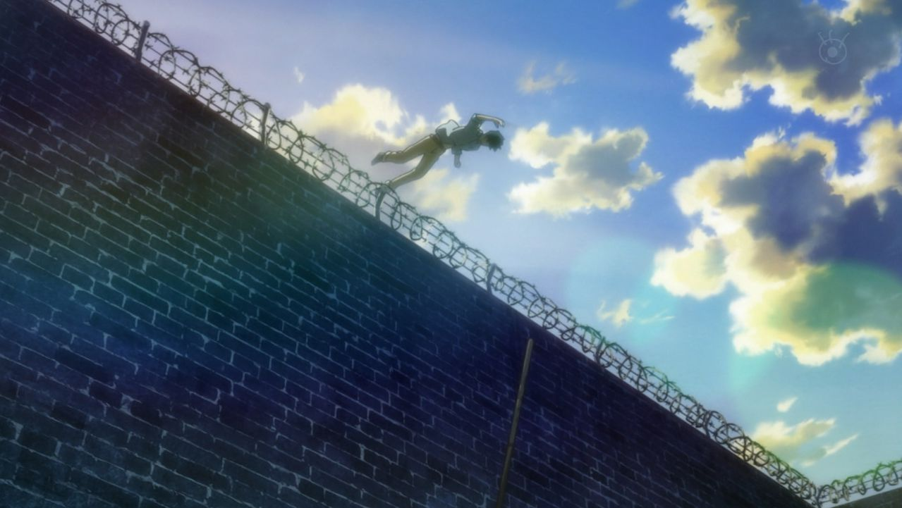 Eiji leaps over the barb wire fence.jpg