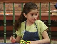 Gianna wearing an apron