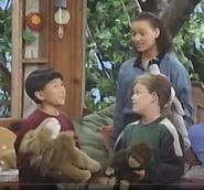 Three kids with three stuffed animals