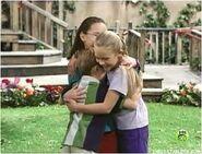 Angela sarah and nick hugging