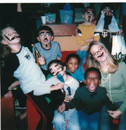 The season 8 cast in class