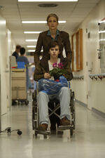 Norma-pushes-norman-in-wheelchair.jpg