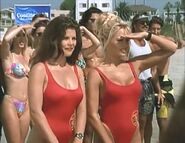 Baywatch - February 4, 1995 - 228 - Caroline (Yasmine Bleeth) & CJ (Pamela Anderson) In Their Red Lifeguard Bathing Suits