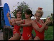 Baywatch - February 17, 1996 - 164 - Caroline (Yasmine Bleeth), Stephanie (Alexandra Paul) & CJ (Pamela Lee) In Their Red Lifeguard Bathing Suits