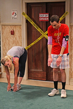 Sheldon and Penny Stretching.jpg