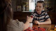 Missy and Sheldon play Thumb-War Checkers