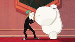 Fred breathes in Baymax