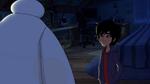 Hiro looks at sleeping Baymax