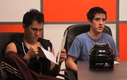 Carlos and Logan at a Meeting